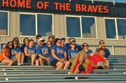 Team Cushman gathers for their team photo on the bleachers at the 2014 Kaw Valley Relay For Life. The team was formed in memory of Tanner Cushman, a 2011 BSHS grad who died in 2012 after a battle with acute myloid leukemia.