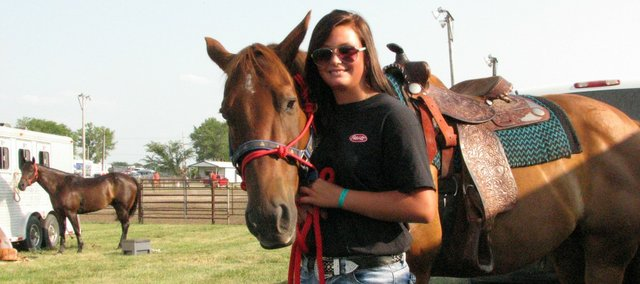 Abby Zule, 13, holds Earl, a rookie barrel racing 15-year-old horse.