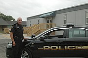 Officer Mike Marshall and the Edwardsville Police Department last week moved into this modular building. The department still plans to put in landscaping, signage and a few other exterior improvements.