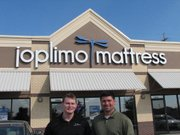 Store Manager Billy Wright (left) and store owner Brian Croft stand in front of the Joplimo Mattress Shawnee location.