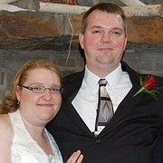 Jon Bieker, pictured with his wife Becky, was killed during an attempted robbery of the She's A Pistol in downtown Shawnee on Friday.