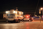 The Shawnee Police Department's mobile command center parked near the scene to give investigators a warm place to work.