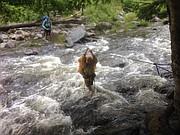 Lawrencian Joanne Renfro crosses a river in Maine on the Appalachian Trail.