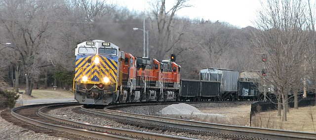 A BNSF train travels south on the Emporia Subdivision railway that travels through central Shawnee.