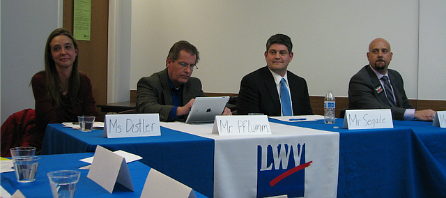 Michelle Distler, Dan Pflumm, Jon Segale and Jeff Vaught participated in a debate hosted by the Johnson County League of Women Voters at the Johnson County Library in Shawnee on Thursday.