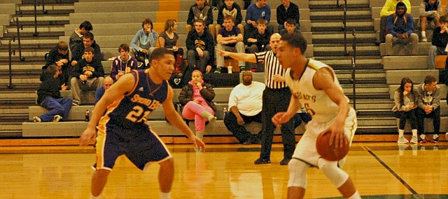 Basehor-Linwood guard Jahron McPherson brings the ball up the court against Spring Hill's Charles Elam.