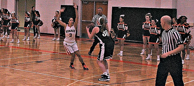 Mill Valley's Catie Kaifes (30) looks to shoot while being defended by Bonner Springs' Julianne Jackson.