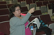 Julia Ybarra-Young, volunteer director of the BSHS/CMS Drama Club, gives students some tips as they rehearse Tuesday.