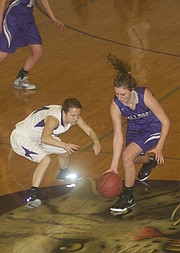 Baldwin senior Maddie Ogle makes a steal in the Bulldogs 44-28 victory Tuesday at Louisburg. The Baldwin defense clamped down on the Wildcats, limiting the home team to just two points in the fourth quarter.