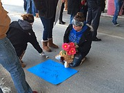 Loved ones make a sign at a vigil Thursday night for Colin Bennett, a 21-year-old Tonganoxie man who died in a vehicle accident early Thursday morning.