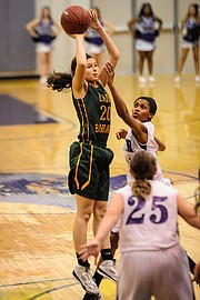 Basehor-Linwood's Zoey Deleon goes up for a shot against Piper.