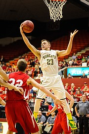 Basehor-Linwood guard Brock Gilliam grabs a rebound during a win over Wellington in the first round of the Class 4A-I state tournament on Wednesday.