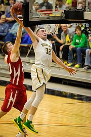 Basehor-Linwood forward Pat Muldoon goes up for a dunk against Wellington on Wednesday at the Class 4A-I state tournament.