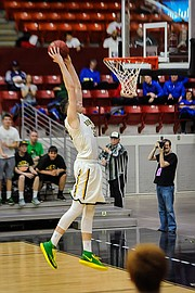 Basehor-Linwood's Pat Muldoon goes up for a dunk against Ottawa on Friday.