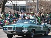 Parade Grand Marshals Neal and Donna Sawyer greet the crowd.