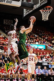 Basehor-Linwood's Pat Muldoon goes up for a shot against McPherson.