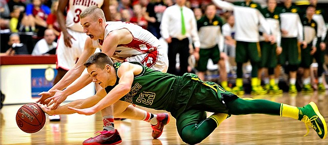 Basehoe-Linwood's Brock Gilliams dives for a loose ball during the Class 4A-I state championship game against McPherson on Saturday.