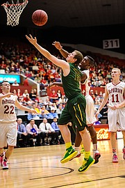 Basehor-Linwood's Carson Fliger goes for a rebound against McPherson.