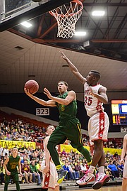 Basehor-Linwood's Jahron McPherson goes for a layup against McPherson.