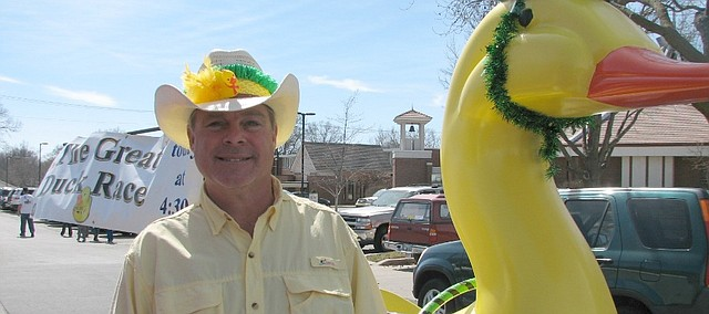 JJ Miller Jr. stands with his giant Duck Race go-cart that he drove in the St. patrick's Day Parade on Sunday.