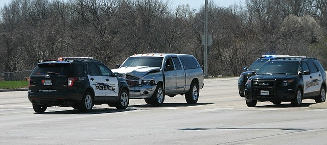 Shawnee police arrested a 38-year-old man following a hit and run accident involving four cars at Shawnee Mission Parkway and Quivira Road Monday afternoon.