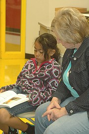 Jackie Lee listens as Kailynn Chamnongchith reads from her book on Tuesday.