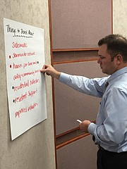 Chad Charest places a marker on a list of key factors that the Street Improvement Program task force will widdle down into a list of criteria that will help them select which street in Shawnee to repair.