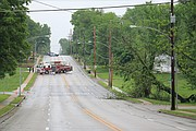 Shawnee firefighters and police officers blocked all traffic on Nieman Road until KCP&L crews could arrive to remove the downed tree and repair the lines.