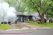 The home at 4829 Lucille in Shawnee was heavily damaged by fire Thursday morning.