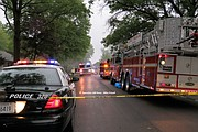 Emergency vehicles lined Lucille Street as firefighters battled the fire.