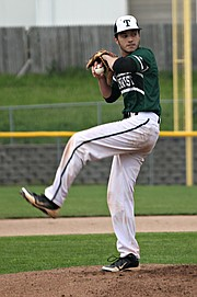 Blue Valley Southwest pitcher Andrew Gillett winds up for a pitch during the regional championship game.