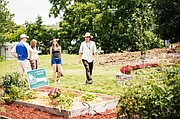 Theo Bunch, farm manager and educator at Gillis Growth Grove, leads a tour of the site during the 2013 Urban Grown Tour. This year's tour will be June 27-28 at several urban farms and gardens across the Kansas City metro area.