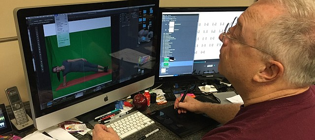 Dennis Dierks, owner of ArtTra Kansas City, works on a design project in the Device Shop's studio.