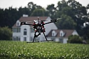 A hexacopter drone is flown by Intelligent UAS, during a drone demonstration at a farm and winery on potential use for board members of the National Corn Growers in Cordova, Md. The small, relatively inexpensive unmanned aerial vehicles could replace humans in a variety of ways around large farms, transmitting detailed information about crops, directing farmers to problem spots and cutting down on the amount of water and chemicals used.