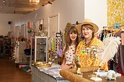 From left, Lauren Tweedie and Cricket Burwell are employees at Donna's Dress Shop, 1410 W. 39th St. It's one of the many interesting shops and restaurants along 39th Street in Kansas City, Mo.