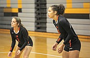 Bonner Springs' Julianne Jackson (10) and Morgan Reed (2) wait for a serve.