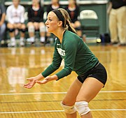 Basehor-Linwood libero Jaime Weible waits to receive a serve.