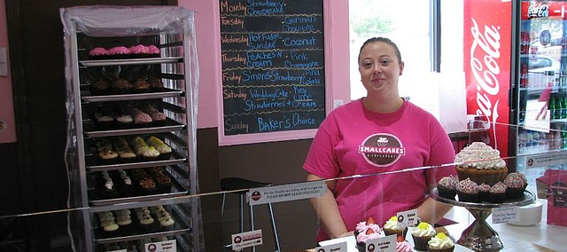 Liz Burks, manager of Smallcakes Shawnee, stands in the business that will soon celebrate its one-year anniversary.
