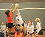 Basehor-Linwood's Madi Osterhaus goes for a kill as Bonner Springs' Julianne Jackson attempts to block.