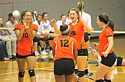 The Bonner Springs volleyball team celebrates a point against Basehor-Linwood.