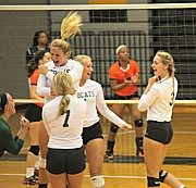 The Basehor-Linwood volleyball team celebrates a point against Bonner Springs.
