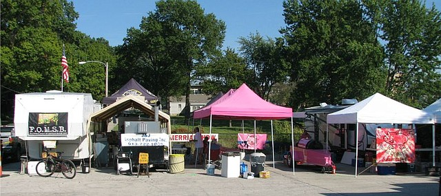 The F.O.M.S.B. tent and Squeal of Approval tents are positioned next to each other each year at Shawnee Great Grillers.