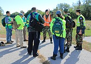 Cadet Second Lieutenant Cole Oakland briefs the search teams at Shawnee Mission Park before they practiced looking for missing campers, played by members of the Heartland Cadet Civil Air Patrol.