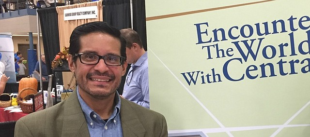 Francisco Litardo stands at Central Baptist Theological Seminary's booth at the SHawnee Business Expo last week.