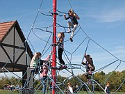 Children gathered to play on the new play area at Erfurt Park.