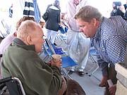 Vice-Mayor Alexander Hilge speaks with former Shawnee Mayor Tony Soetaert.