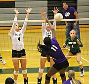 Basehor-Linwood's Jenna Mussett (4) and Courtney Robinson (5) go up for a block against Piper.