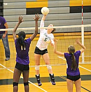 Basehor-Linwood's Courtney Robinson goes for a kill against Piper.