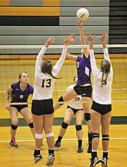 Basehor-Linwood's Madi Osterhaus (3) and Katie Yankovich (13) go for a block against Piper.