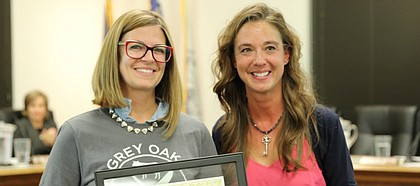 Lindsey McDonald accepts the first Good Neighbor award presented by Mayor Michelle Distler.